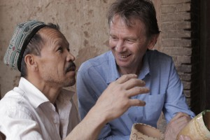 Story of China_Michael Wood in Kashgar old town with a local potter
