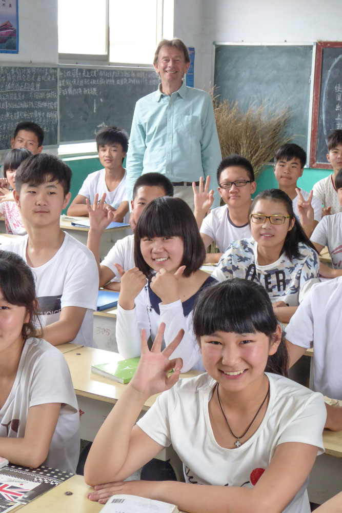 Michael Wood with students at Yanshi middle school where there is a tomb monument to poet Du Fu