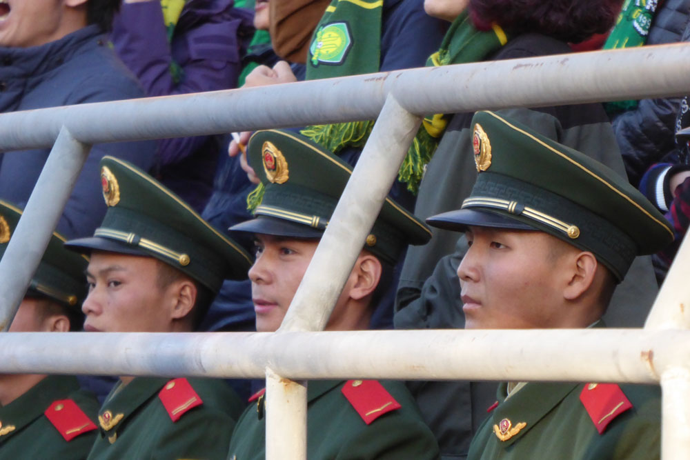 Public security bureau officers at the football match